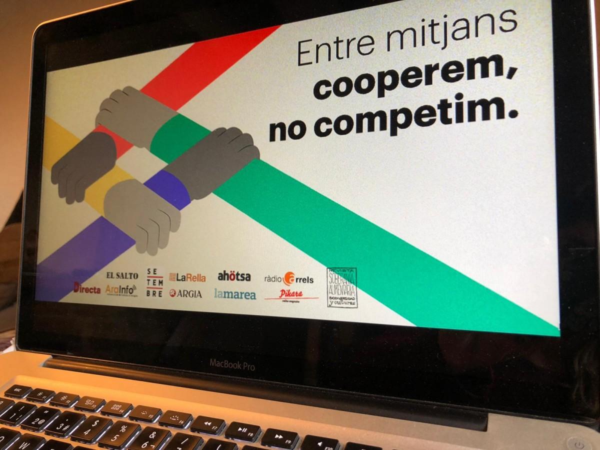 El bàner de la campanya conjunta «Entre mitjans cooperem, no competim»
